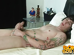Stud with a ton of tats stroking his dick