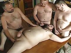 Mature homosexuals relax on kitchen