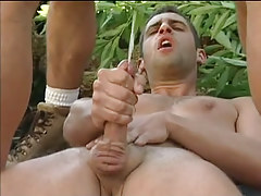 Three muscle gays cum by turns in forest