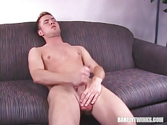 Horny dude jerks off on sofa