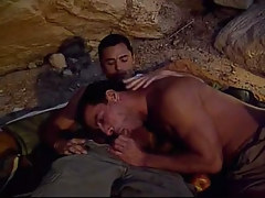 Muscle gay guy sucks cock in cave