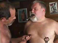 Lusty old gay guys caress nipples with cigar