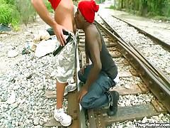 Ebony twink serves white ally on railyard