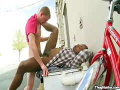 Black and white homosexuals smoking outdoor